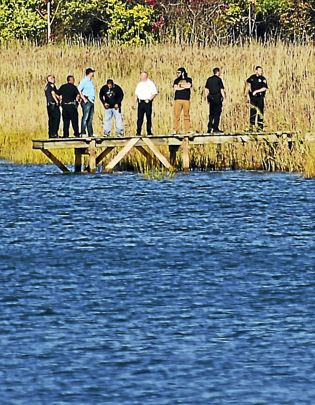 Police search by the Quinnipiac River in the area of 318 Quinnipiac Ave. in New Haven for one of the occupants of a car that led police in a pursuit Tuesday.