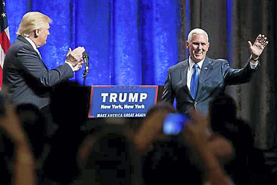 "Republican presidential candidate Donald Trump, left, introduces Gov. Mike Pence, R-Ind., during a campaign event to announce Pence as the vice presidential running mate on, Saturday, July 16, 2016, in New York. Trump called Pence ""my partner in this campaign"" and his first and best choice to join him on a winning Republican presidential ticket. Photo: AP Photo — Mary Altaffer"