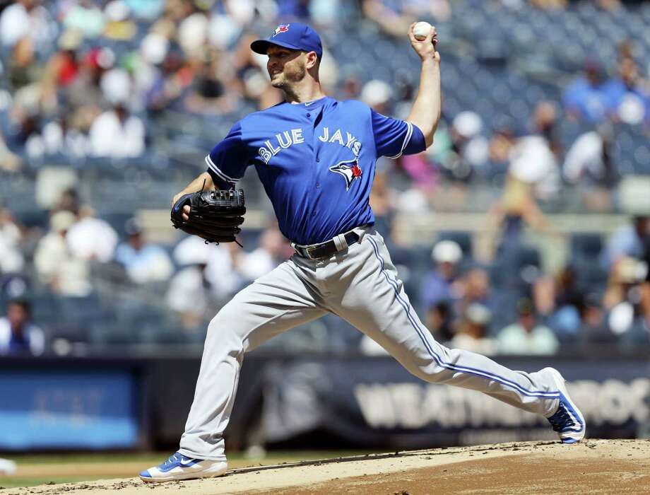 Toronto Blue Jays starting pitcher J.A. Happ won his 11th consecutive decision to become the first 17-game winner in the majors. The Blue Jays defeated the Yankees 7-4 on Wednesday. Photo: Seth Wenig — The Associated Press   / Copyright 2016 The Associated Press. All rights reserved. This material may not be published, broadcast, rewritten or redistribu