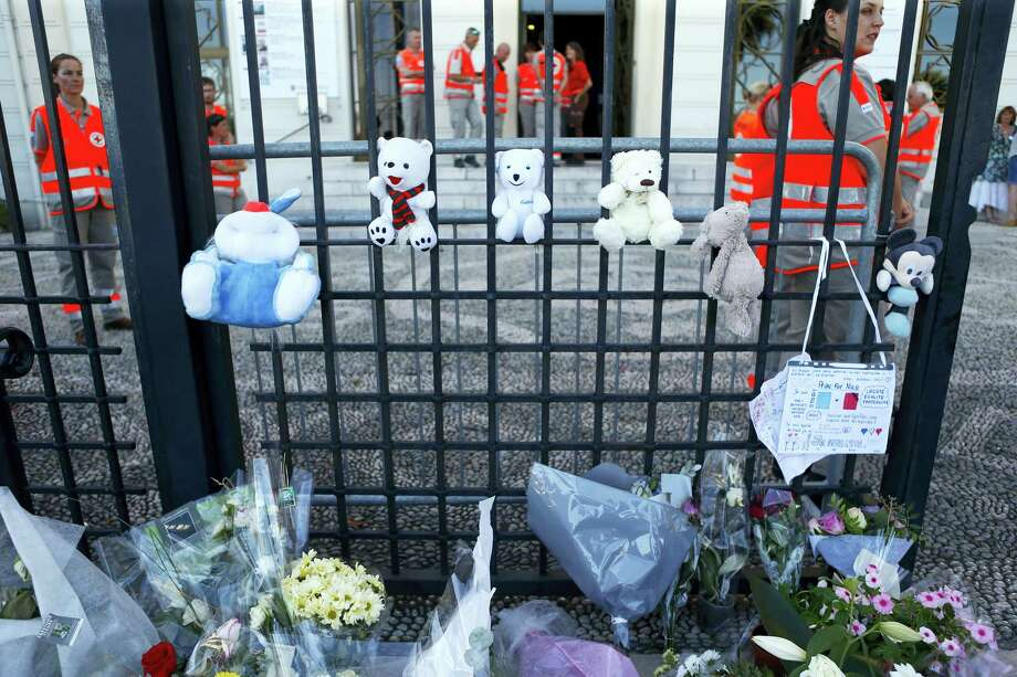 """Teddy bears and flowers are placed in tribute of the victims of the deadly truck attack in front of a temporary emergency centre on the famed Promenade des Anglais in Nice, southern France, Saturday, July 16, 2016. French Interior Minister Bernard Cazeneuve says that the truck driver who killed 84 people when he careened into a crowd at a fireworks show was """"radicalized very quickly."""" Photo: AP Photo/Francois Mori    / AP"""