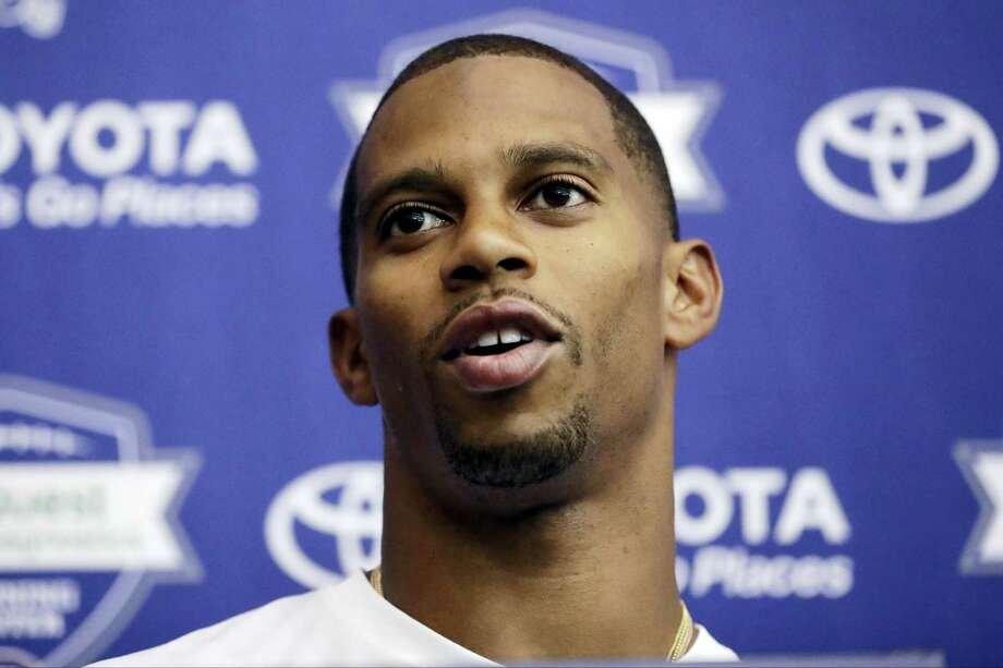 FILE - In this July 29, 2016, file photo, New York Giants wide receiver Victor Cruz talks to reporters during NFL football training camp in East Rutherford, N.J. The oft-injured  Cruz isn't giving up on his hope to play for the Giants. The 29-year-old wide receiver remained optimistic Wednesday, Aug. 17, 2016, despite being sidelined the past few days by a groin injury. (AP Photo/Julio Cortez, File) Photo: AP / AP