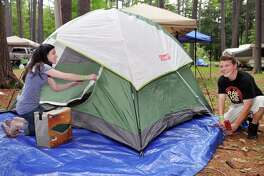 Campers Amy Thomas,left, and her boyfriend set up a tent at Hearthstone Point Campground on Lake George Saturday afternoon May 28, 2011.   (John Carl D'Annibale / Times Union)