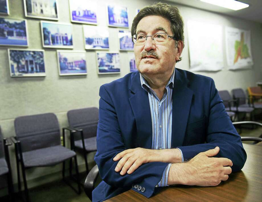 (Peter Hvizdak - New Haven Register)  Carl J. Amento, executive director of the South Central Regional Council of Governments, last week in the North Haven office of the SCRCOG. Photo: ©2016 Peter Hvizdak / ©2016 Peter Hvizdak