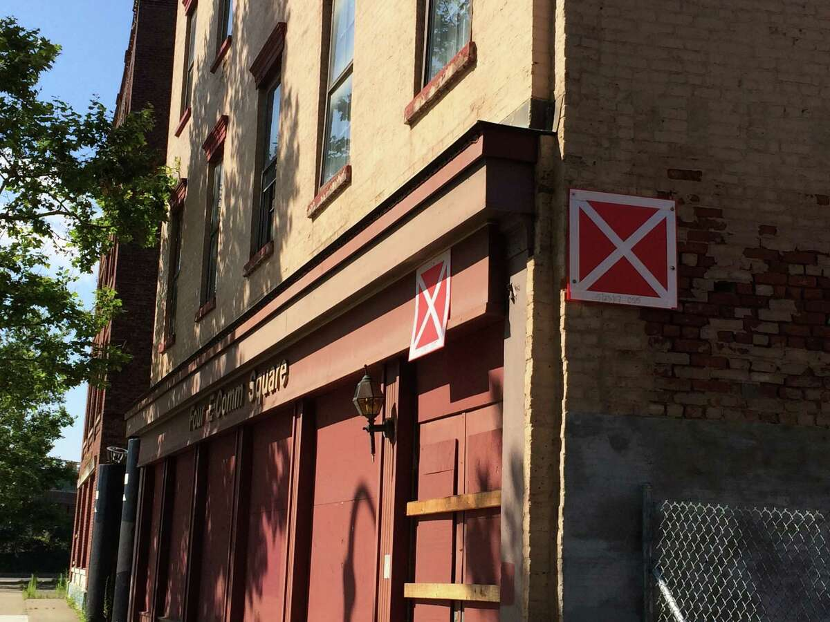 Red 'x' placards have been placed on E-Commerce Square buildings owned by a state-run public authority on Broadway in Albany as seen July 19, 2017. (Lauren Stanforth/Times Union)