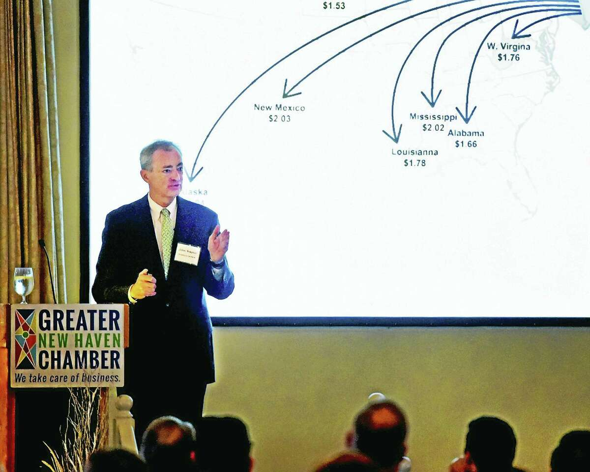John Traynor, People's United Bank chief investment officer, speaks at the Greater New Haven Chamber of Commerce Economic Outlook Breakfast at the New Haven Lawn Club Thursday.