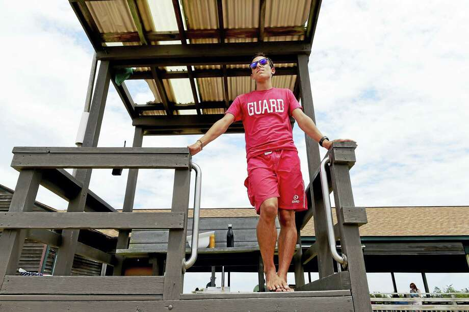 Hammonasset Beach State Park lifeguard Anthony Marzitelli keeps a watchful eye Friday on East Beach at the state park in Madison. Photo: Peter Hvizdak — New Haven Register   / ©2016 Peter Hvizdak