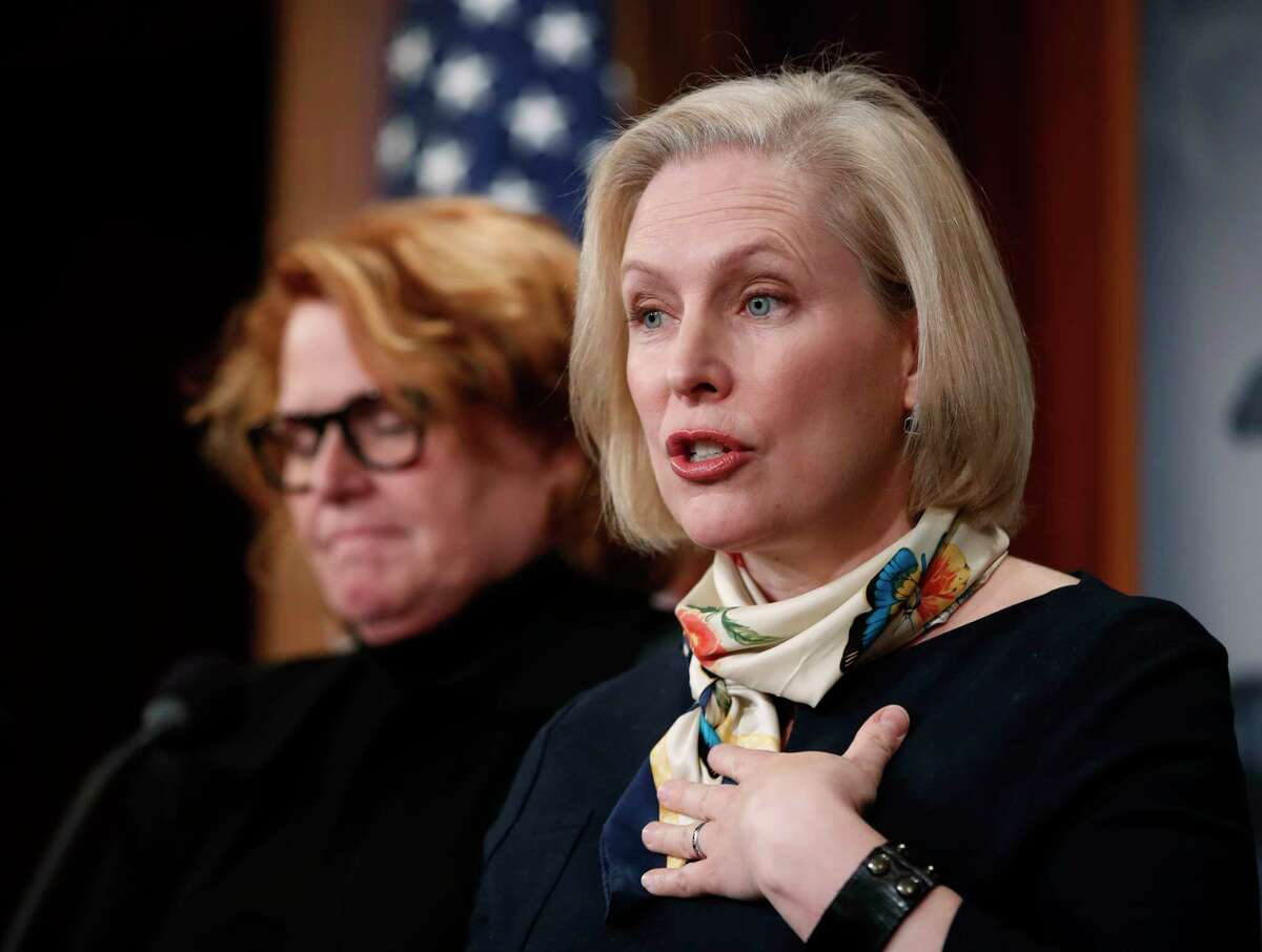 Sen. Kirsten Gillibrand, D-N.Y., right, accompanied by Sen. Heidi Heitkamp, D-N.D., speaks to reporters during a news conference about the Family Act, Tuesday, March 14, 2017, on Capitol Hill in Washington. (AP Photo/Manuel Balce Ceneta) ORG XMIT: DCMC102