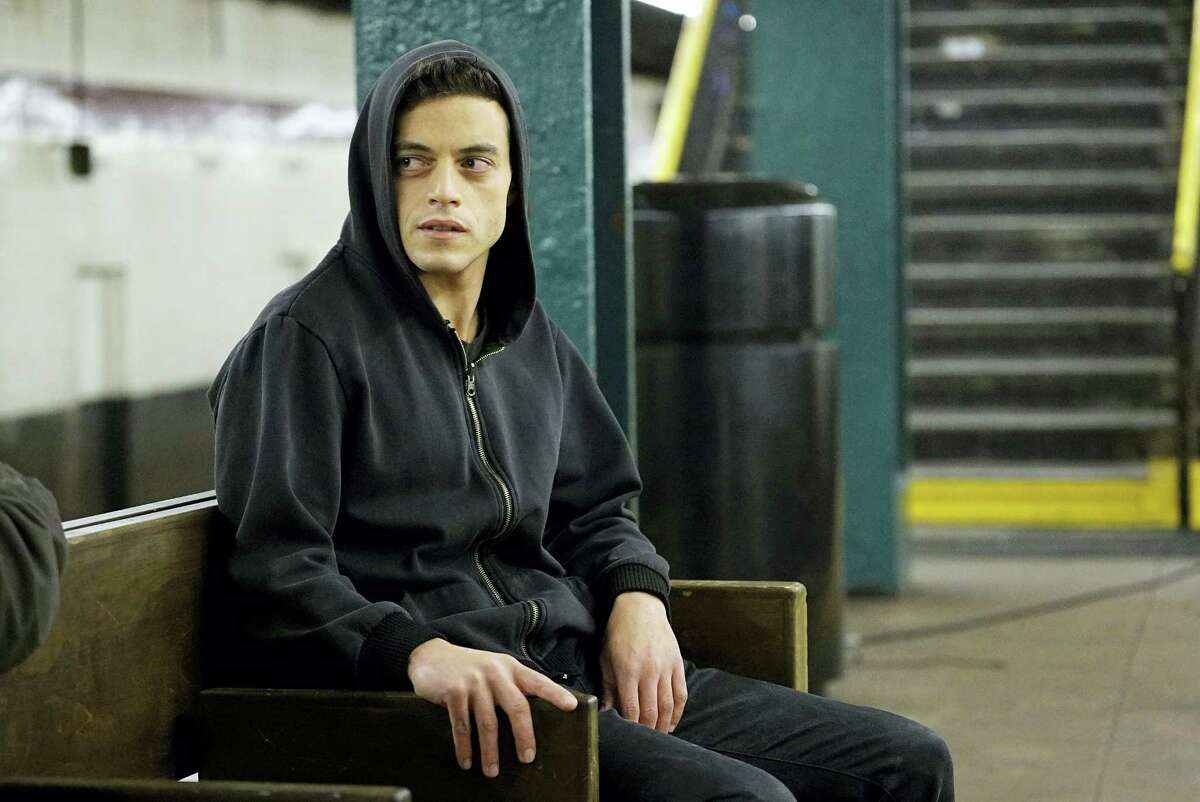 """In this image released by USA Network, Rami Malek appears in a scene from, """"Mr. Robot."""" On July 14, 2016, Malek is nominated for outstanding actor in a drama series for his role. The 68th Primetime Emmy Awards will be broadcast live Sunday on ABC beginning at 8 p.m. ET on ABC."""
