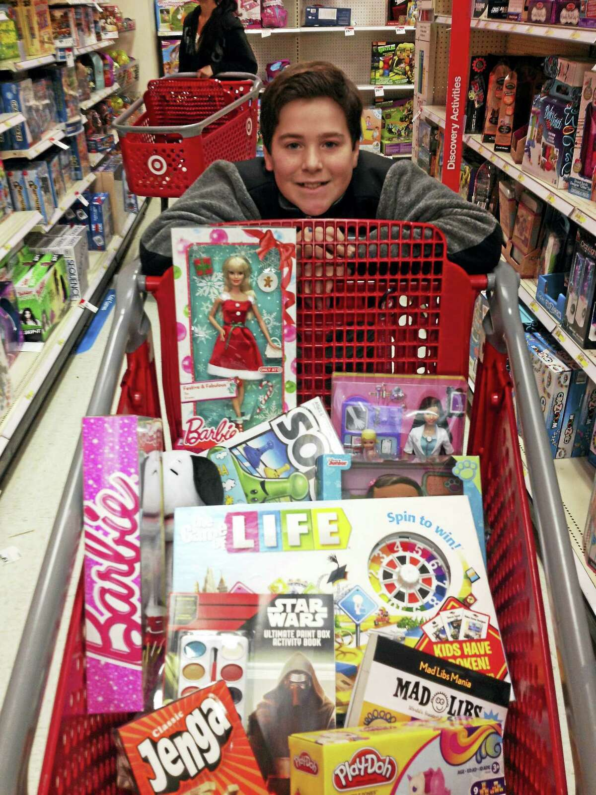 Matt Gagliardi loads up his shopping cart with toys for YNHCH's Toy Closet.