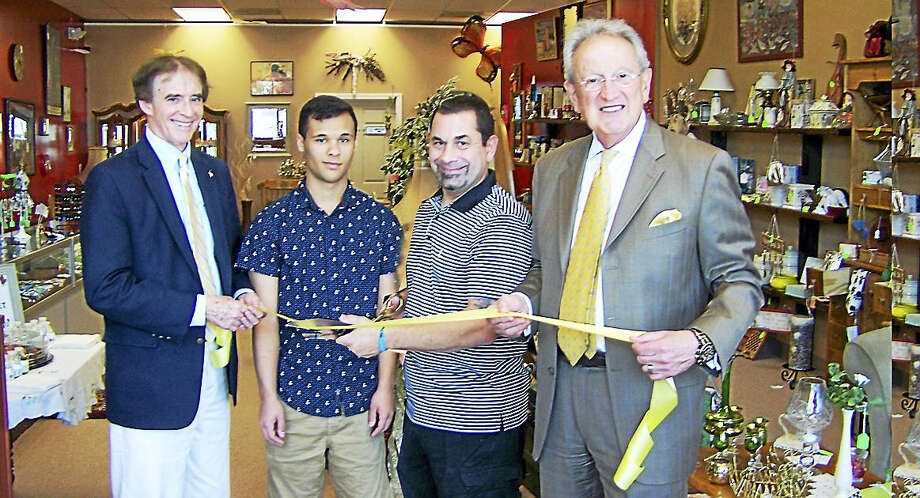 START SHOPPING: From left, Wallingford Mayor William Dickinson; Bellju Consignments owners  Willie Scott Lockman and Michael Munno; and Quinnipiac Chamber of Commerce and Greater New Haven Chamber of Commerce President Tony Rescigno celebrate the grand opening recently of Bellju Consignments, 200 Church St. The store offers household items, gifts, collectibles, furniture and vintage antiques. Not in photo is store owner Cheryl Barys-Lockman-Munno. Photo: CONTRIBUTED PHOTO