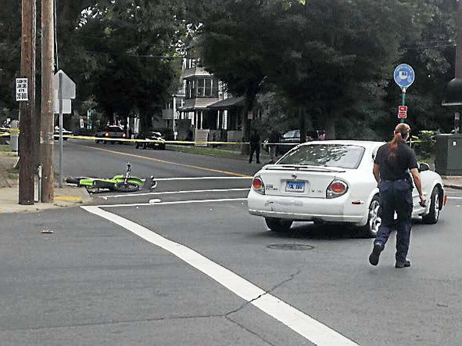 The scene at the corner of Bassett Street and Shelton Avenue Saturday. Photo: JULIEMAR ORTIZ — NEW HAVEN REGISTER