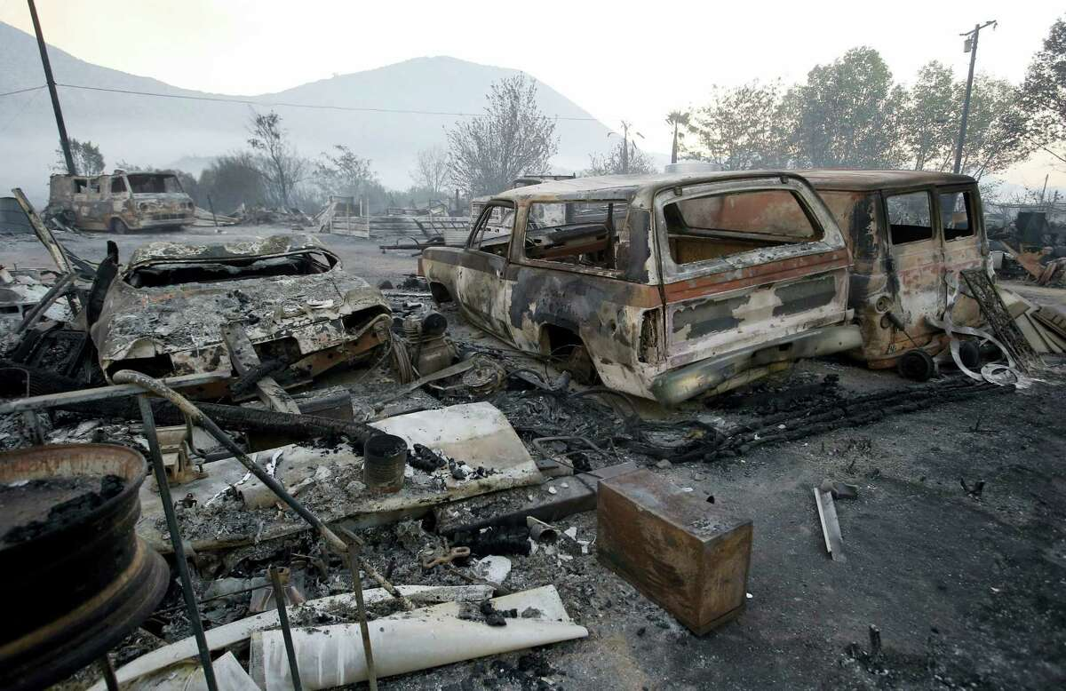 Burned property at Hess Road and Highway 138 shows the devastation of the BlueCut fire in West Cajon Valley, Calif., Wednesday, Aug. 17, 2016.