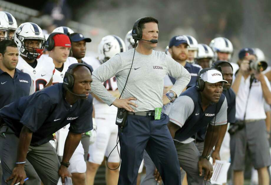 Connecticut head coach Bob Diaco, center, stands on the sideline in the second half of an NCAA college football game against Navy in Annapolis, Md., Saturday, Sept. 10, 2016. (AP Photo/Patrick Semansky) Photo: AP / AP