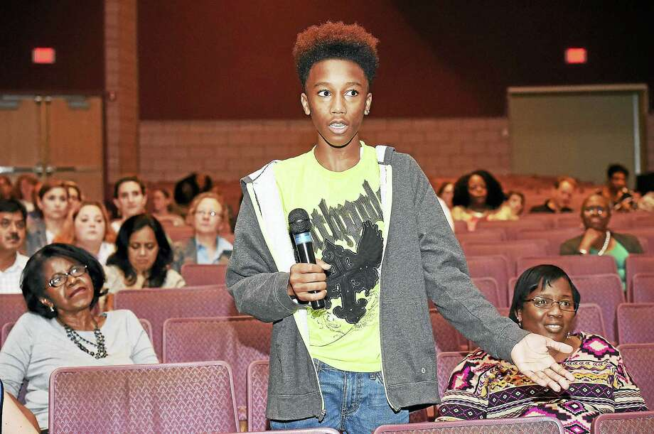 James Hillhouse High School freshman Jesse Campbell, 14, speaks about the lack of materials in the classroom during a community meeting Tuesday about the future of New Haven Public Schools, at Hill Regional Career High School in New Haven. Photo: Catherine Avalone — New Haven Register   / New Haven RegisterThe Middletown Press