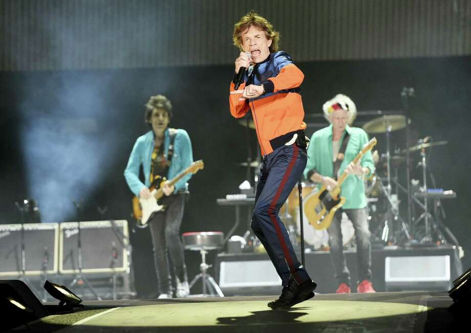 In this Oct. 7, 2016 photo, Mick Jagger, center, performs with Ron Wood, left, and Keith Richards of the Rolling Stones during their performance on day 1 of the 2016 Desert Trip music festival at Empire Polo Field in Indio, Calif.  Jagger, the 73-year-old frontman of the Rolling Stones, was on hand Dec. 8, 2016 at a New York hospital when girlfriend, Melanie Hamrick, gave birth to the couple's son. Photo: Photo By Chris Pizzello/Invision/AP   / Invision