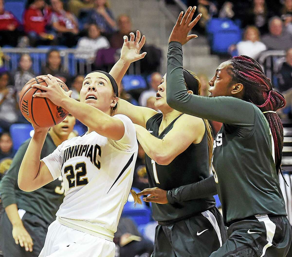 Quinnipiac junior guard Brittany Johnson looks for the hoop as Michigan State's Tori Jankoska (1) and Victoria Gaines (15) defend in a 71-54 loss for the Bobcats Tuesday at the TD North Sports Center at Quinnipiac University.