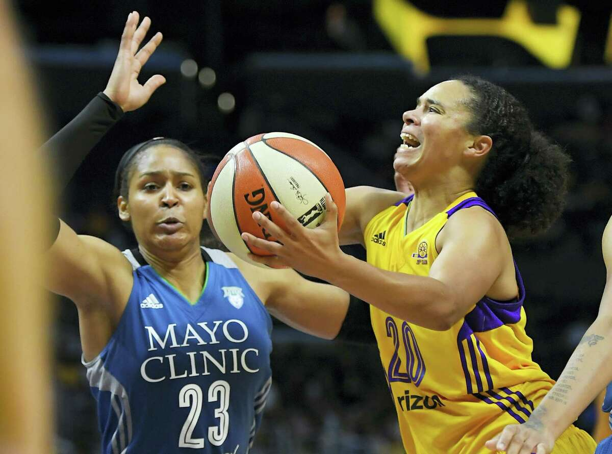 Los Angeles Sparks guard Kristi Toliver, right, shoots as Minnesota Lynx forward Maya Moore defends during the second half in Game 4 of the WNBA Finals on Oct. 16 2016, in Los Angeles. The Lynx won 85-79.