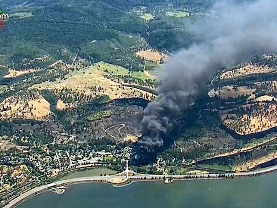 In this June 3 frame from video, smoke billows from a Union Pacific train that derailed near Mosier, Ore., in the scenic Columbia River Gorge. U.S. safety officials say they've seen slow progress in efforts to upgrade or replace tens of thousands of rupture-prone rail cars used to transport oil and ethanol, despite a string of fiery derailments. Photo: KGW-TV Via AP   / KGW-TV