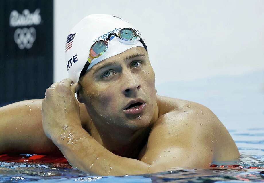 In this story of August 9, 2016 , American swimmer Ryan Lochte appears after competing in a heat at the Olympic Games in Rio de Janeiro. Photo: AP Photo/Michael Sohn, File   / AP
