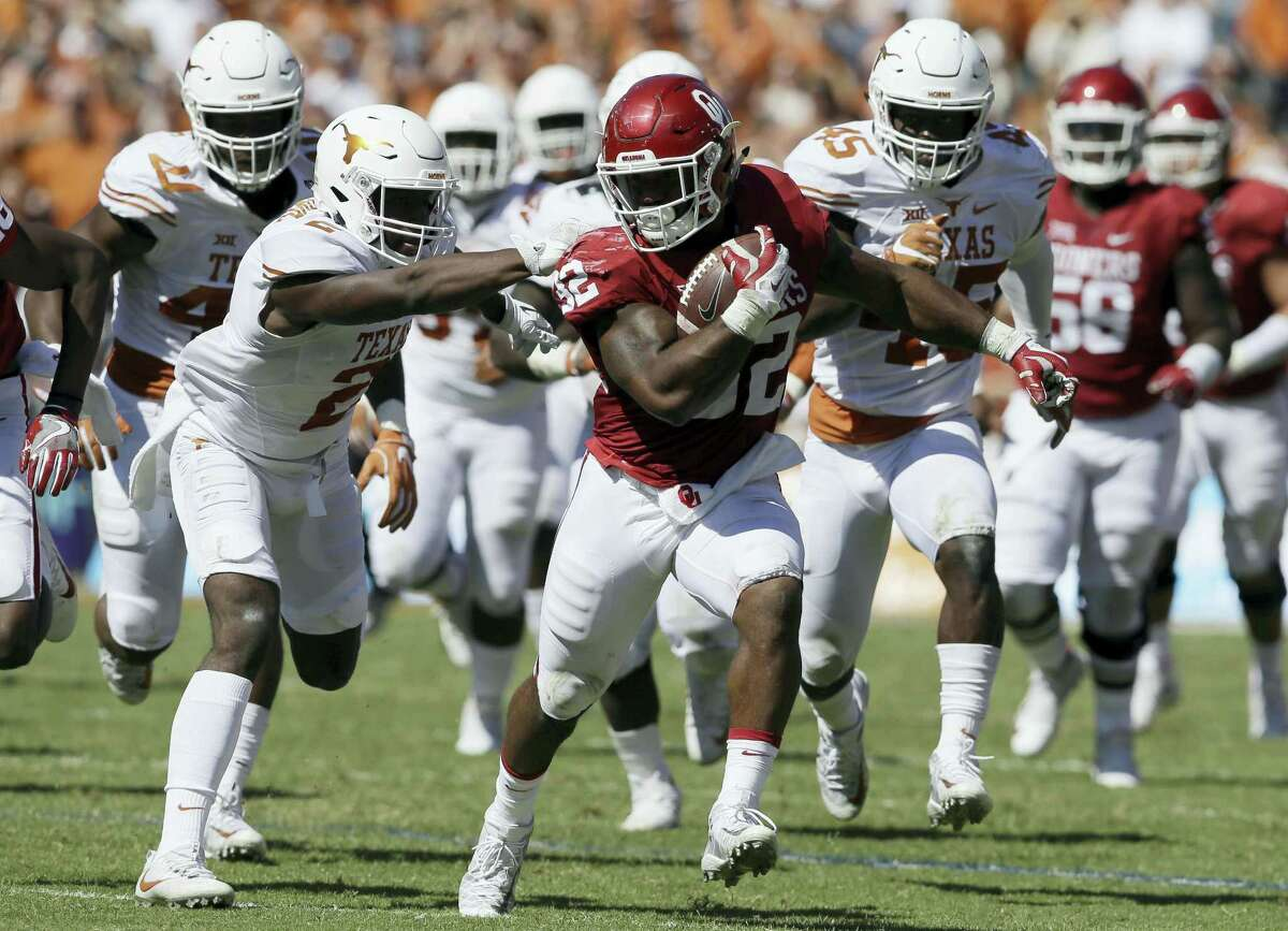 In this Oct. 8, 2016 photo, Oklahoma running back Samaje Perine (32) runs against Texas cornerback Kris Boyd (2) during an NCAA college football game in Dallas. Oklahoma faces Kansas State this week in a Big 12 game.