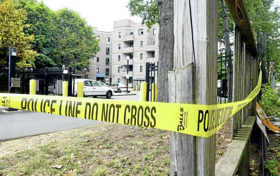 New Haven Police investigate the scene at Matthew Ruoppolo Manor on Ferry Street in New Haven Tuesday, where a man with a knife was shot by police. Photo: Arnold Gold — New Haven Register