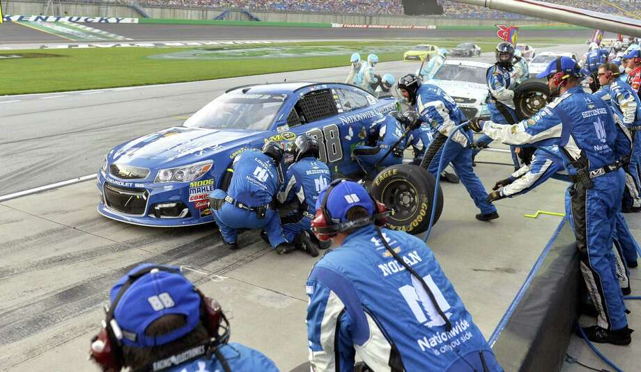 Dale Earnhardt Jr. makes a pit stop during last week's race in Kentucky. With Earnhardt sidelined with concussion symptoms, retired Jeff Gordon might take his place at the Brickyard next week. Photo: The Associated Press File Photo   / FR43398 AP