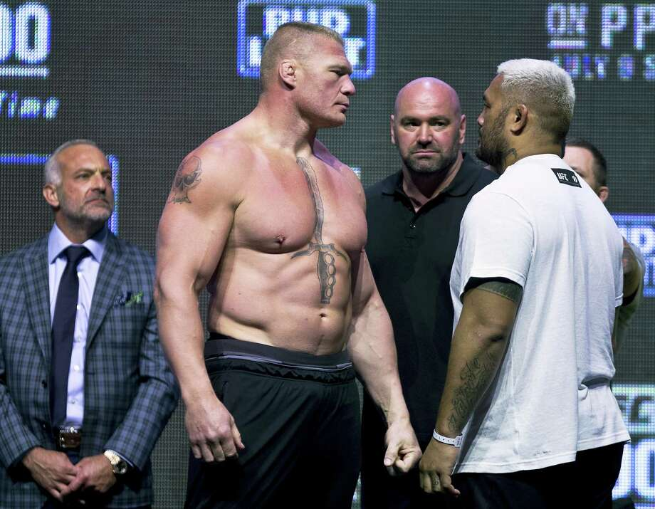 Brock Lesnar, left, looks at Mark Hunt during the UFC 200 weigh-ins in Las Vegas. Photo: L.E. Baskow — Las Vegas Review-Journal Via AP   / Las Vegas Review-Journal