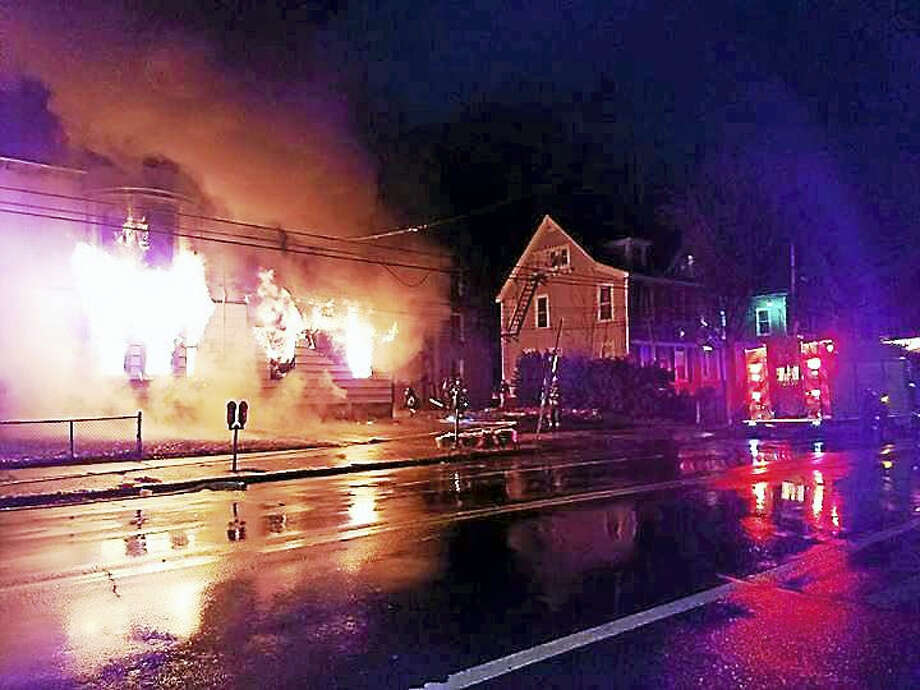 New Haven fire crews battled a two-alarm fire early Wednesday at 1471 Chapel St. Photo: Courtesy Of New Haven Fire Department