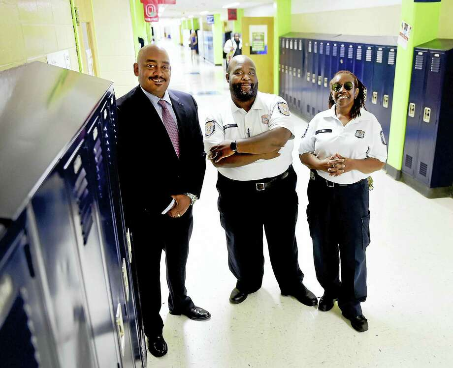 (Peter Hvizdak - New Haven Register)  From left, Thaddeus Reddish, New Haven Public Schools director of school security with Derrick Powell, special police officer and supervisor of school security and Starr Birt, supervisor of school security at Hillhouse High School in New Haven last week. Photo: ©2016 Peter Hvizdak / ©2016 Peter Hvizdak