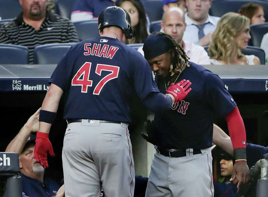 Travis Shaw (47) celebrates with Hanley Ramirez after hitting a two-run home run against the Yankees during the fifth inning on Friday. Photo: JULIE JACOBSON - The Associated Press   / Copyright 2016 The Associated Press. All rights reserved. This material may not be published, broadcast, rewritten or redistribu