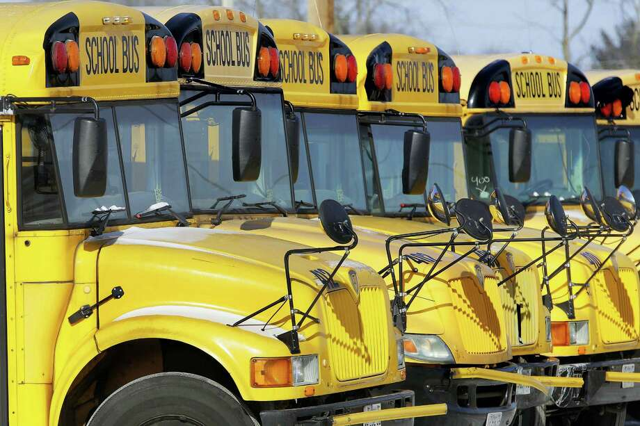 FILE - In this Jan. 7, 2015 file photo, public school buses are parked in Springfield, Ill. The lazy days of summer are ending for millions of children as they grab their backpacks, pencils and notebooks and return to the classroom for a new school year. No more staying up late during the week. Farewell to sleeping in. And, hello homework! Photo: FILE Photo / Copyright 2016 The Associated Press. All rights reserved. This material may not be published, broadcast, rewritten or redistribu