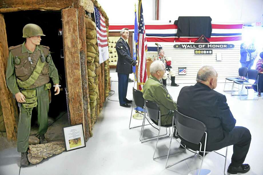 Wayne Rioux, center, veterans liaison for Hartford HealthCare at Home, speaks during the Veteran's Wall of Honor Dedication Ceremony at the West Haven Veterans Museum and Learning Center in West Haven on Saturday. Photo: Arnold Gold — New Haven Register