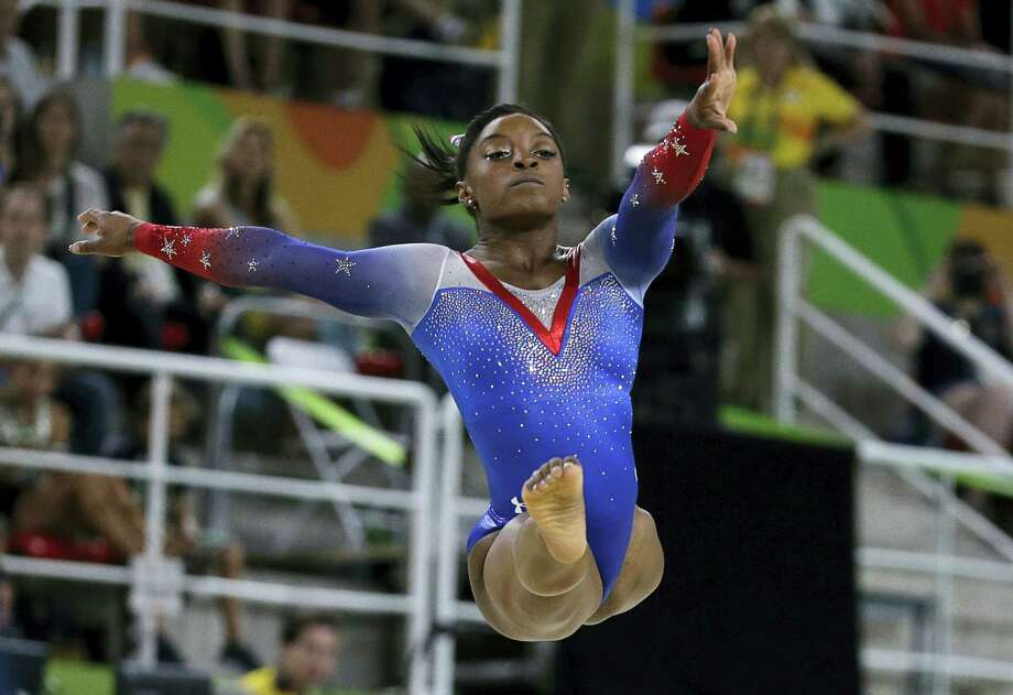 Simone Biles of the United States won the floor on Tuesday for her fourth gold medal of the 2016 Summer Olympics in Rio de Janeiro, Brazil. Photo: Rebecca Blackwell — The Associated Press   / Copyright 2016 The Associated Press. All rights reserved. This material may not be published, broadcast, rewritten or redistribu