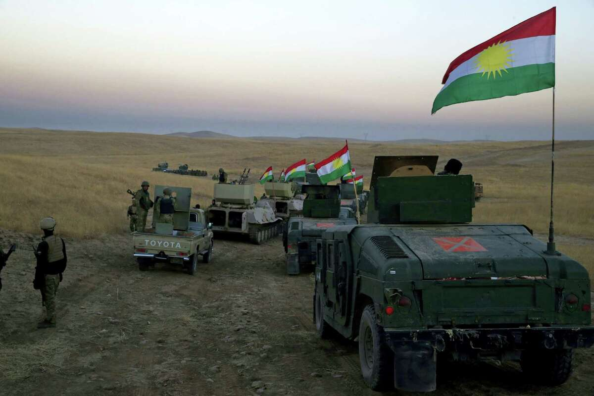 A Peshmerga convoy drives towards a frontline in Khazer, about 30 kilometers (19 miles) east of Mosul, Iraq on Oct. 17, 2016. The Iraqi military and the country's Kurdish forces say they launched operations to the south and east of militant-held Mosul early Monday morning.