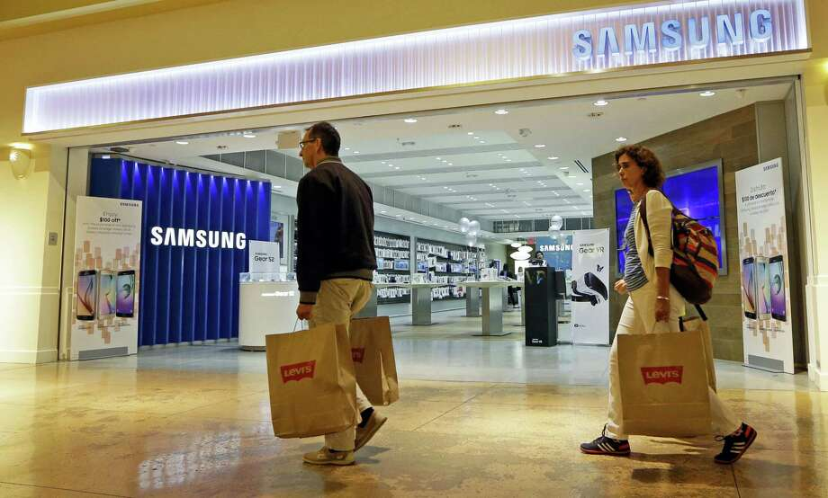 In this photo taken Tuesday, Feb. 9, 2016, shoppers walk by a Samsung store in Miami. On Friday, July 15, 2016, the Commerce Department releases U.S. retail sales data for June. Photo: AP Photo/Alan Diaz    / Copyright 2016 The Associated Press. All rights reserved. This material may not be published, broadcast, rewritten or redistribu