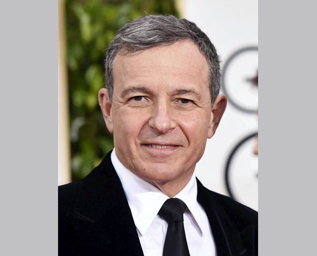"""In this Jan. 11, 2015 photo, chairman and CEO of the Walt Disney Company, Robert A. Iger, arrives at the 72nd annual Golden Globe Awards in Beverly Hills, Calif. Iger, is working on a book about """"leadership and management."""" Random House announced Monday that Iger would reflect on the """"ideas, values and growth strategies"""" that have underlined his 11 years running the entertainment giant. The book, which will include his thoughts on such key decisions as the acquisition of Pixar, is currently untitled and does not yet have a release date."""
