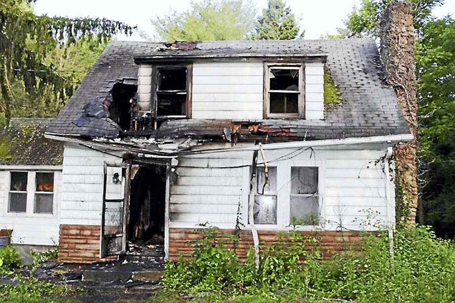Fire investigators are asking the public to help them find the person who allegedly set a fire at 229 Bear Hill Road in Bethany. The vacant home burned early Saturday. Photo: Courtesy Of Bethany Volunteer Fire Department