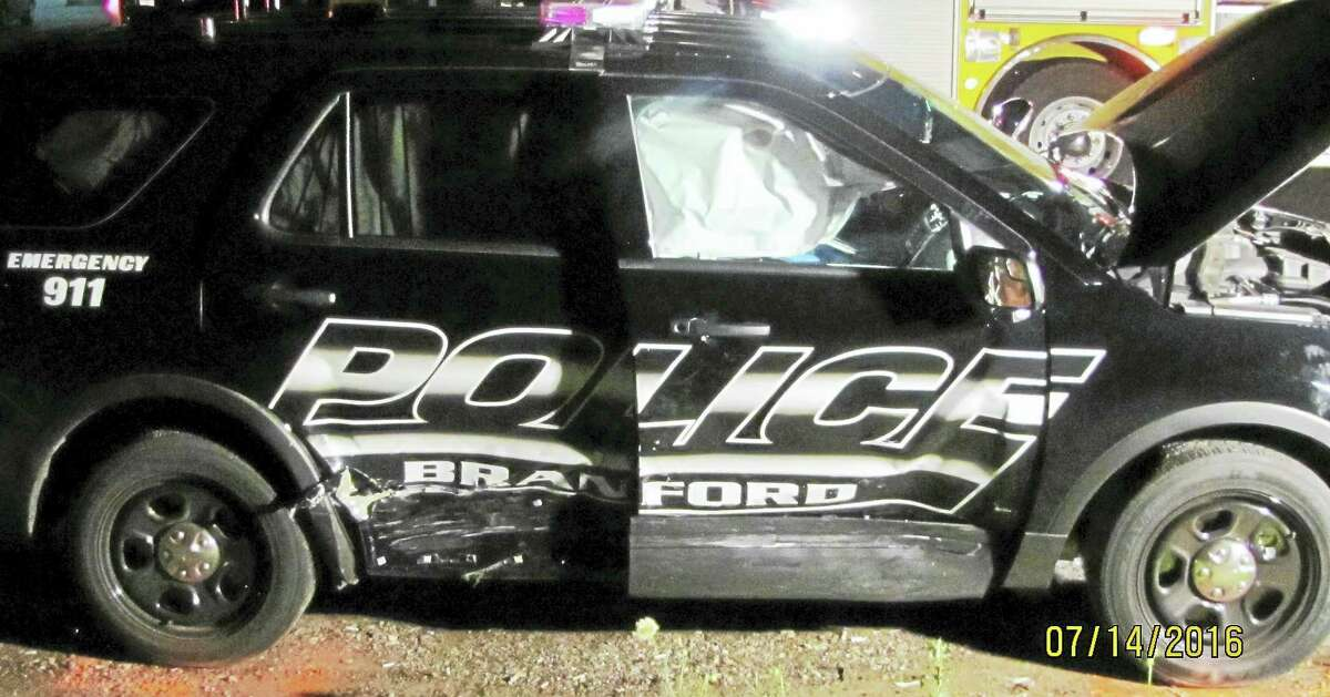 Two Branford police officers were taken to the hospital Thursday night after their cruiser was hit by another vehicle whose driver was allegedly under the influence. The officers had been responding to an emergency call at the time of the crash.