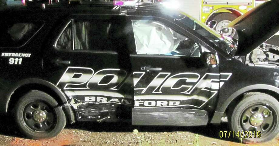 Two Branford police officers were taken to the hospital Thursday night after their cruiser was hit by another vehicle whose driver was allegedly under the influence. The officers had been responding to an emergency call at the time of the crash. Photo: Courtesy Of Branford Police Department