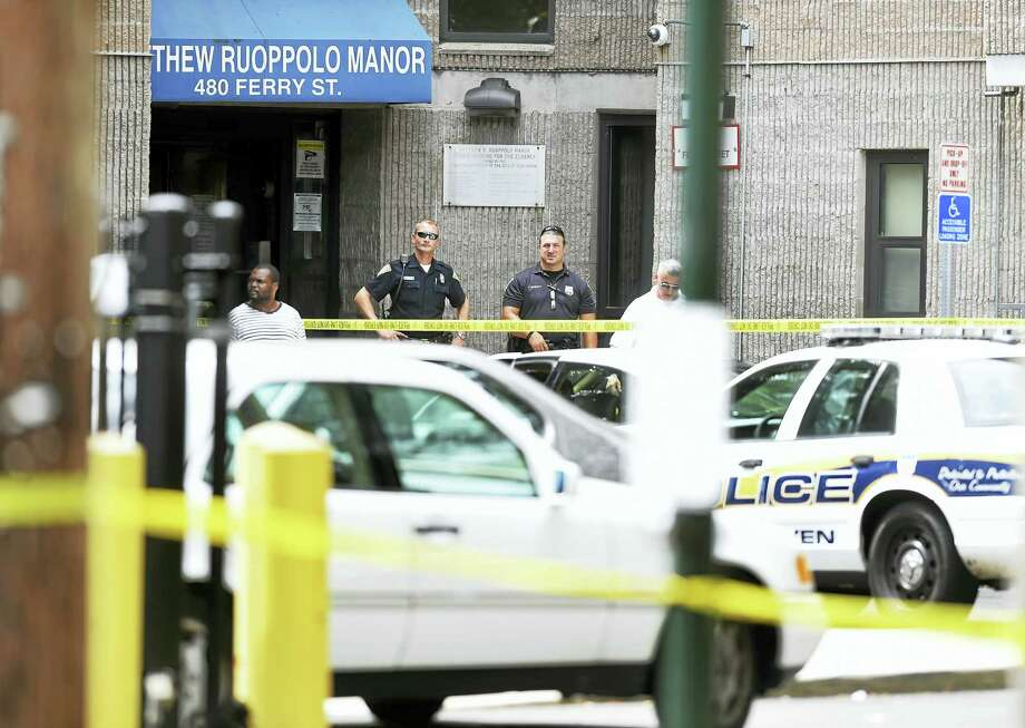 New Haven Police investigate the scene at Matthew Ruoppolo Manor on Ferry Street in New Haven where a man was shot by police on Tuesday. Photo: Arnold Gold-New Haven Register