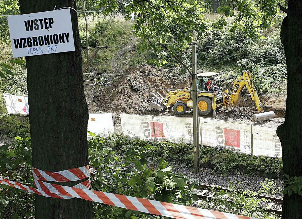 """Heavy machinery begins the search, the work of explorers hoping to find a legendary Nazi train laden with treasure and armaments in Walbrzych, Poland, on Tuesday Aug. 16, 2016. The search attests to the power of a local legend claiming a Nazi """"gold"""" train disappeared in a mountain tunnel as the Germans escaped the advancing Soviet army at the end of World War II."""