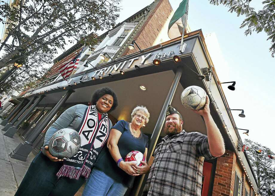 From left, Imani Williams of the American Outlaws New Haven, Jeannine McCann, a committee member, and chairman James Namnoum, a member of VFW Post 12150, organizers of Kick for Nick. Photo: Catherine Avalone — New Haven Register   / New Haven RegisterThe Middletown Press