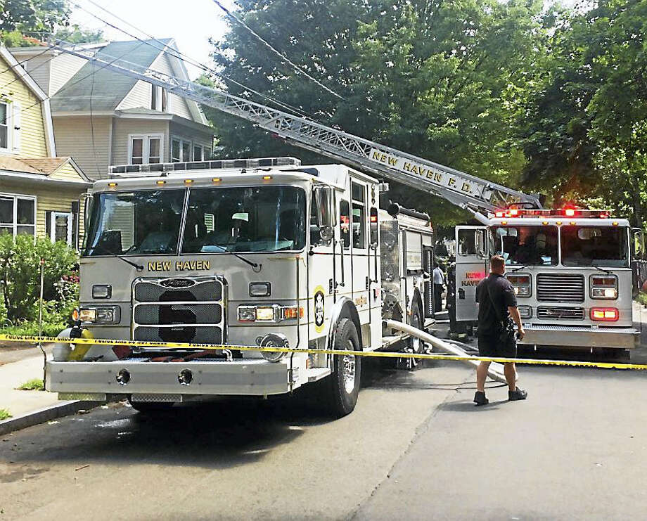 New Haven firefighters quickly knocked down a fire Friday afternoon in the third floor of a home on County Street in the city's Dixwell section. No one was hurt in the fire, which broke out at about 2:15 p.m. Photo: (Photo Courtesy Of Frank Ricci)