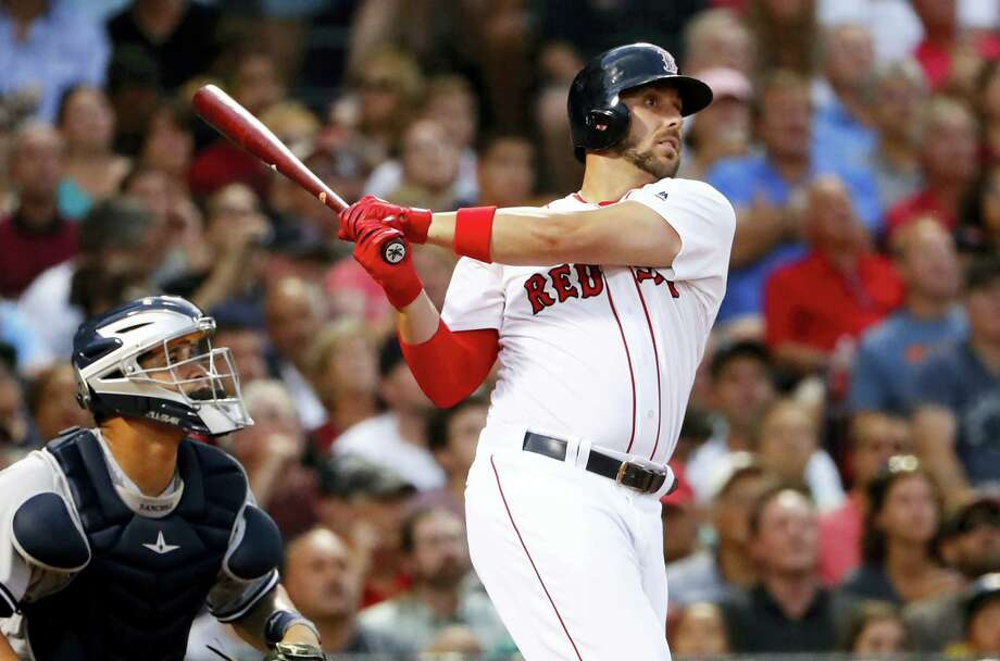 In this file photo, Boston Red Sox's Travis Shaw watches a hit against the New York Yankees during the third inning of a baseball game at Fenway Park in Boston. The Boston Red Sox got the man they wanted _ a setup man, in fact. The AL East champions locked down their eighth-inning spot Tuesday acquiring right-hander Tyler Thornburg from the Milwaukee Brewers in a package that included infielder Travis Shaw . Photo: Winslow Townson — The Associated Press File   / FR170221 AP
