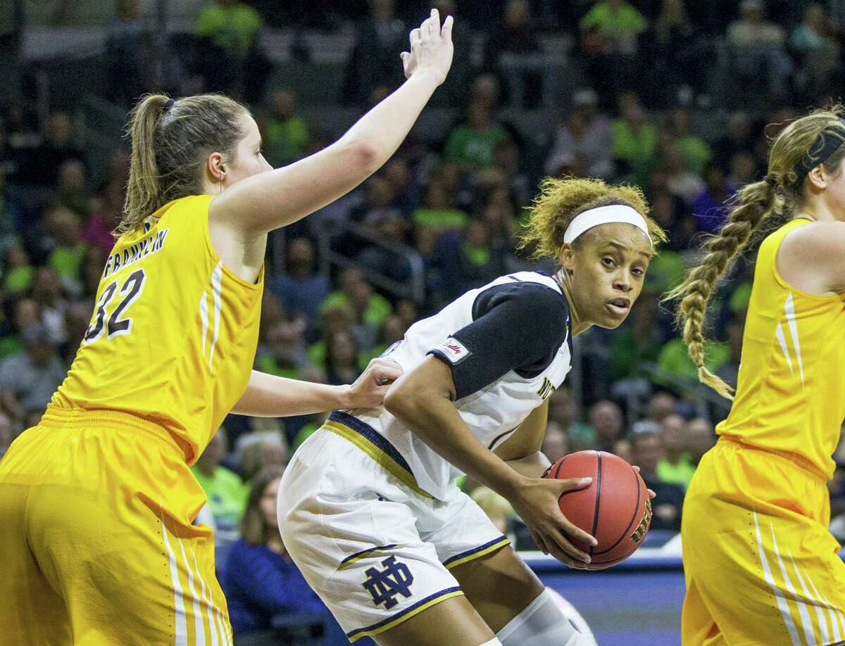 Notre Dame's Brianna Turner, center, is pressured by Valparaiso's Dani Franklin (32) during the second half of Notre Dame's win on Sunday. Turner could pose some problems for UConn tonight.
