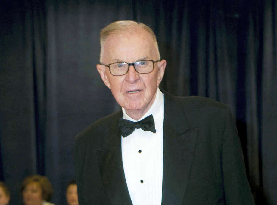 "John McLaughlin arrives at the White House Correspondents' Association Dinner in Washington in 2012. McLaughlin, the conservative political commentator and host of the namesake long-running television show that pioneered hollering-heads discussions of Washington politics, died Tuesday, Aug. 16, 2016, according to the Facebook page for ""The McLaughlin Group."" He was 89. Photo: AP Photo — Kevin Wolf, File / FR33460 AP"