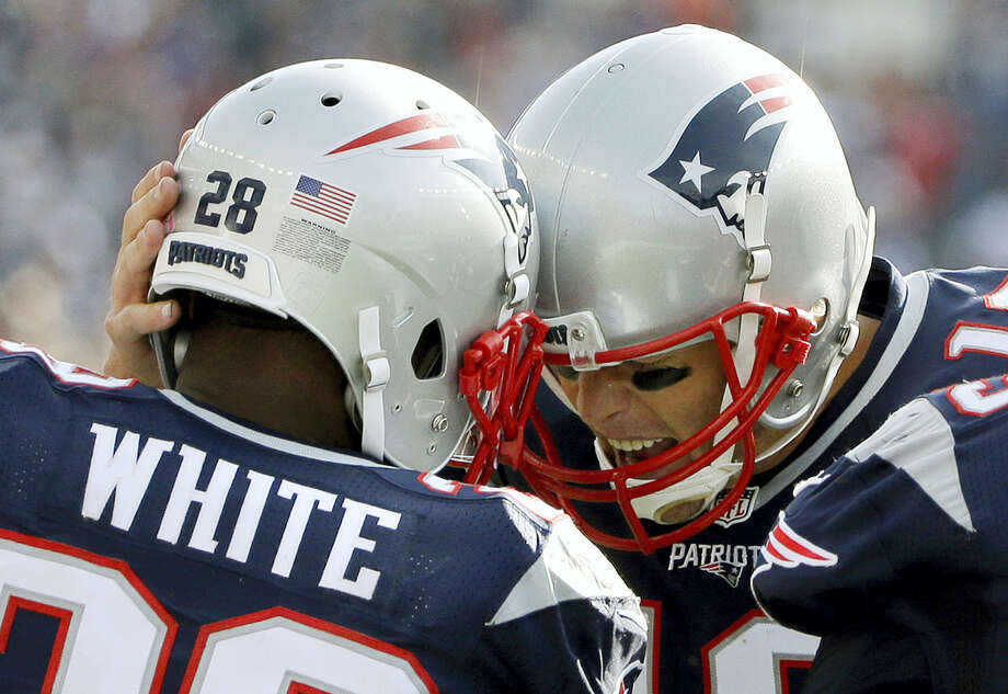 Patriots running back James White (28) celebrates his touchdown with quarterback Tom Brady on Sunday. Photo: Elise Amendola — The Associated Press   / Copyright 2016 The Associated Press. All rights reserved.
