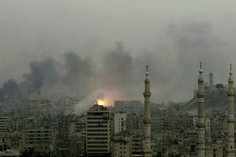 A ball of fire rises following a Syrian government airstrike that hit rebel positions in the eastern neighborhoods of Aleppo, Syria, Monday. Photo: Hassan Ammar — The Associated Press   / Copyright 2016 The Associated Press. All rights reserved.