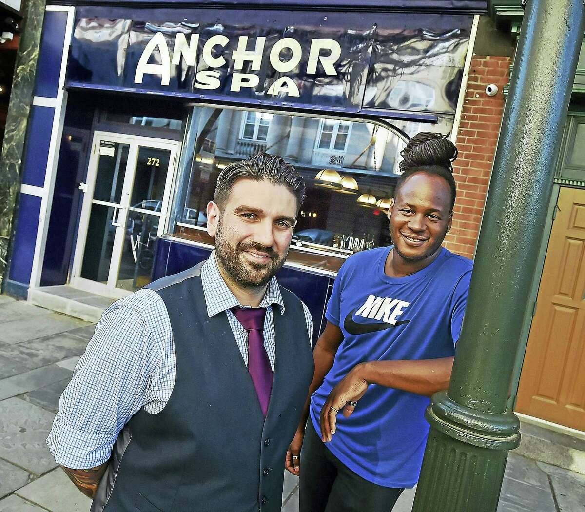 Karl Franz Williams of New York City, at right, owner of Anchor Spa at 272 College St., with his manager and partner, Dimitrios Zahariadis of Waterbury, have crafted a variety of mixed drinks inspired from ports around the globe and small plates with a focus on seafood and local game.