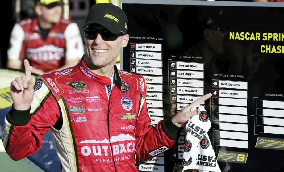 Kevin Harvick advanced to the next round of NASCAR's Chase for the Sprint Cup with a win Sunday at Kansas Speedway. Photo: Colin E. Braley — The Associated Press   / FR123678 AP